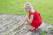 Gardener in dress and high heels — Stock Photo