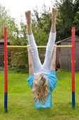 Woman exercising on backyard playground — Stock Photo