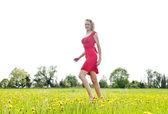 Happy meadow walking woman — Stockfoto