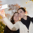 Stock Photo: Girlfriends with smartphone