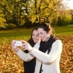 Girlfriends with smartphone — Stock Photo #36497247