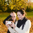 Cheerful sisters with smartphone — Stock Photo #36497327