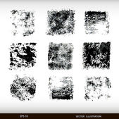 Set of different textural spots. Grunge textures set. — Stock Vector