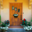 Weathered wood stained home door - Stok fotoğraf