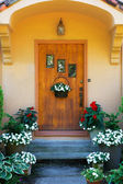 Weathered wood stained home door — Stock Photo