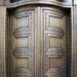 Foto Stock: Big Brass Revolving Bank Doors up close