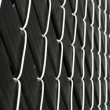 Imbedded cyclone fence — Stock Photo #19309993