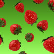 Falling strawberries  — Stock Photo