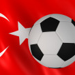 Soccer ball on turkish flag background — Stock Photo
