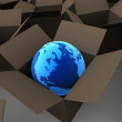 Earth globe in cardboard box — Stock Photo