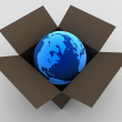 Royalty-Free Stock Photo: Earth globe in cardboard box