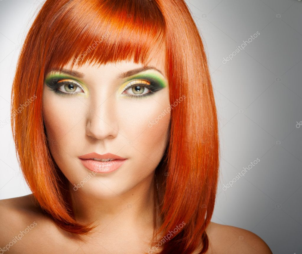 Beautiful Woman with Red Hair and bright makeup  Stock Photo #12697798