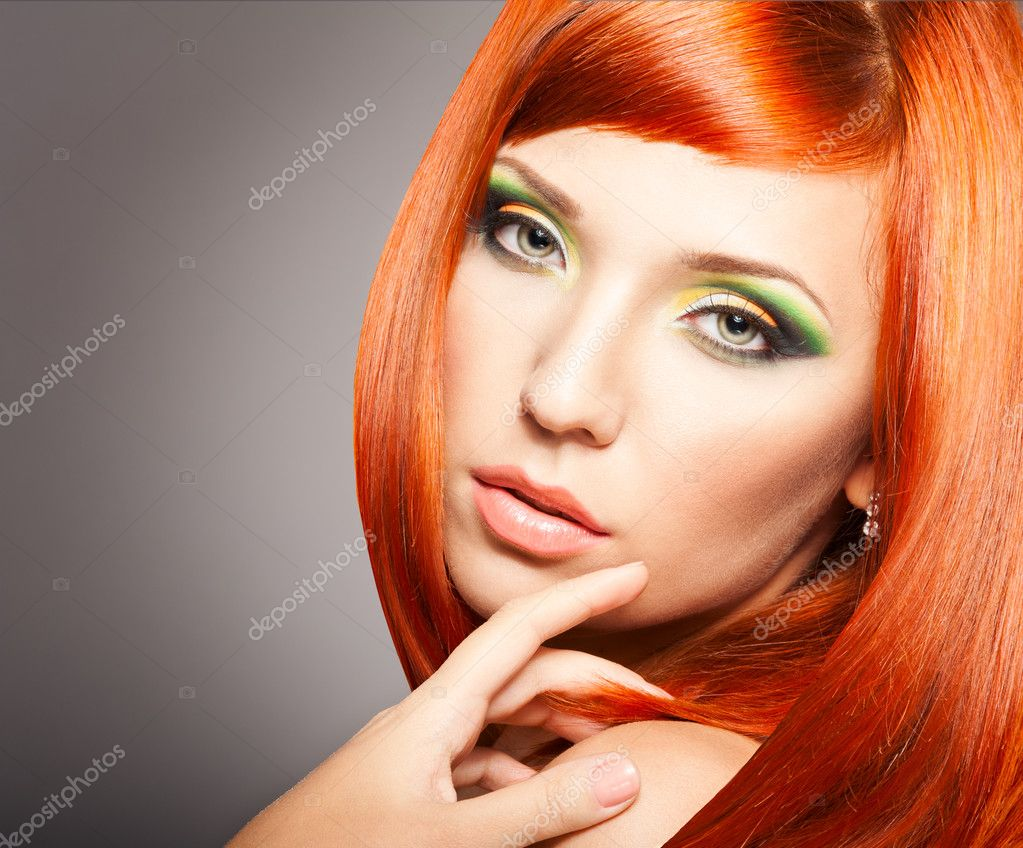 Beautiful Woman with long Red Hair and bright makeup — Stock Photo #12732229
