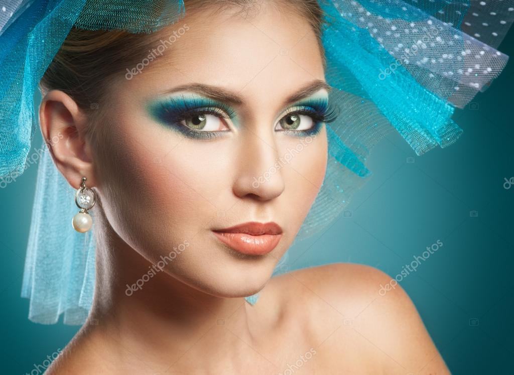 Beautiful woman with blue make-up — Stock Photo #13433831