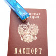 Stock Photo: Passport and blue stepler