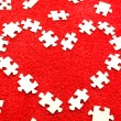 Puzzle on a red fabric - Stock Photo