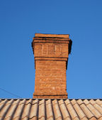 Bricks chimney on the roof — Stock Photo