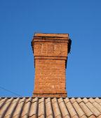Bricks chimney on the roof — Stock Photo