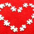 Stock Photo: Puzzle on red fabric