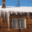 Icicles on a roof — Stock Photo