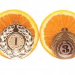 Medal and an orange on a white background - Stock Photo