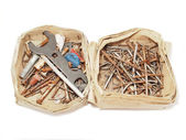 Box of nails and tools on a white background — Stock Photo