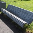 Stock Photo: Bench in park with urn