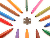 Color felt-tip pens and puzzle — Stockfoto