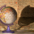 Globe on a map of — Stock fotografie