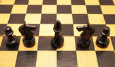 Chess on a chess board — Stockfoto
