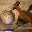 Globe and hammer on the map background — Stock Photo