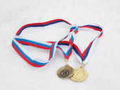 Medals on a snow — Stock Photo