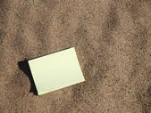 Notebook on sand — Stock Photo