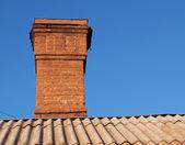 Brick chimney house — Stock Photo