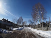 Road in winter village — Stock Photo