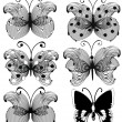 Set of abstract openwork black butterflies isolated on white — Stock Vector