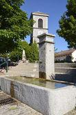 Fountain and church at Saint Paul en Chablais in France — Stock Photo