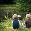 Stock Photo: Two boys on a pond