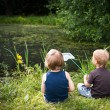 Foto Stock: Two boys on pond