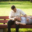 Pregnant woman with her husband in the park — Stock Photo