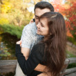 Loving couple embracing in autumn park — Stock fotografie