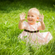 Cute little girl shows her hands — Stock Photo