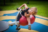 A child on a swing — Stock Photo