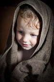 Cute baby in towel — Stock Photo