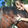 Stock Photo: Girl and horse. Photographed by lens Zenith.