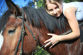 Girl and horse. Photographed by a lens the Zenith. — Stock Photo