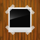 Photo on a wooden surface — Stock Vector
