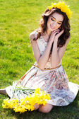 Happy smiling girl with yellow flowers — Stock Photo