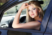Nice blonde girl with her car — Stock Photo