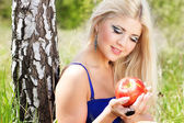 Young woman with basket of apples — Stock Photo